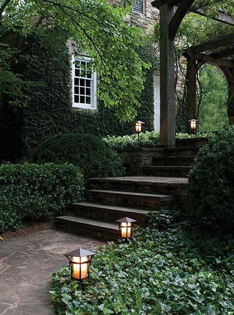 Path Lighting, Garden Stone Walkway With Ivy And Boxwoods.