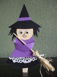 looks like it's just paper, foam, doily, and popsicle stick. I think we could make the broom out of other things.