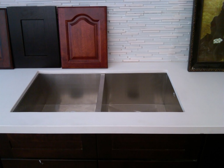 White backsplash with white counters.: White Counter