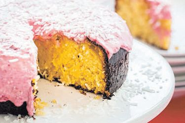 Lemon, golden syrup and coconut cake with raspberry cream cheese icing