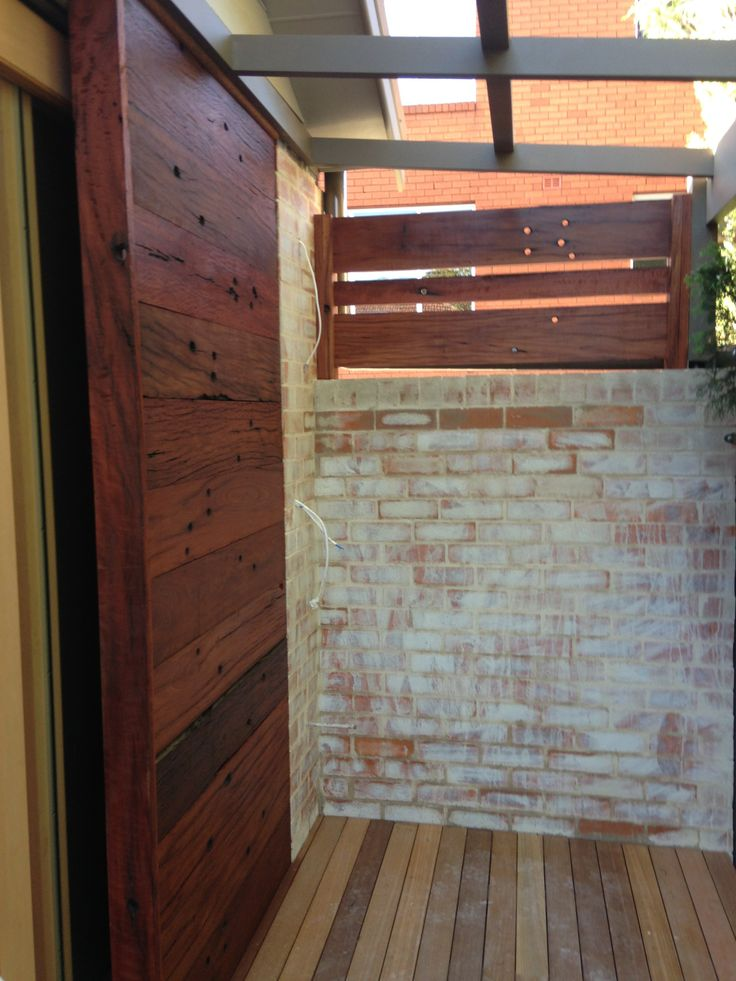 Decking completed and feature Redgum panelling to the sliding door cavity and privacy screen installed.