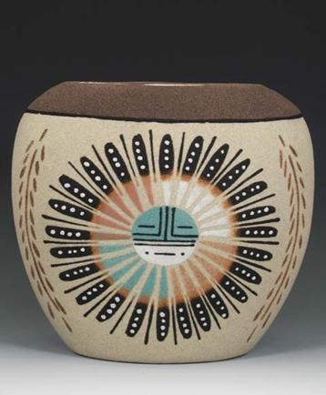 NAVAJO SAND PAINTED POTTERY    This incredible piece comes from the Navajo nation and was hand painted using traditional sand painting techniques with asunface design