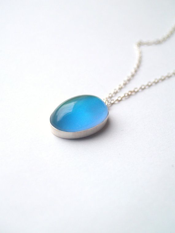 A large, bold and simple mood necklace. Changes colors just like the old rings!    I do have a few pieces of jewelry that have real vintage mood stones