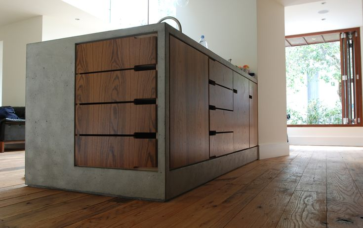 abcg architecture. Super cool combo of wood and concrete for a kitchen island