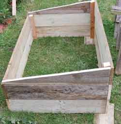 How to build build a simple cold frame from few cheap or recycled materials. An easy cold frame design for the green gardener.