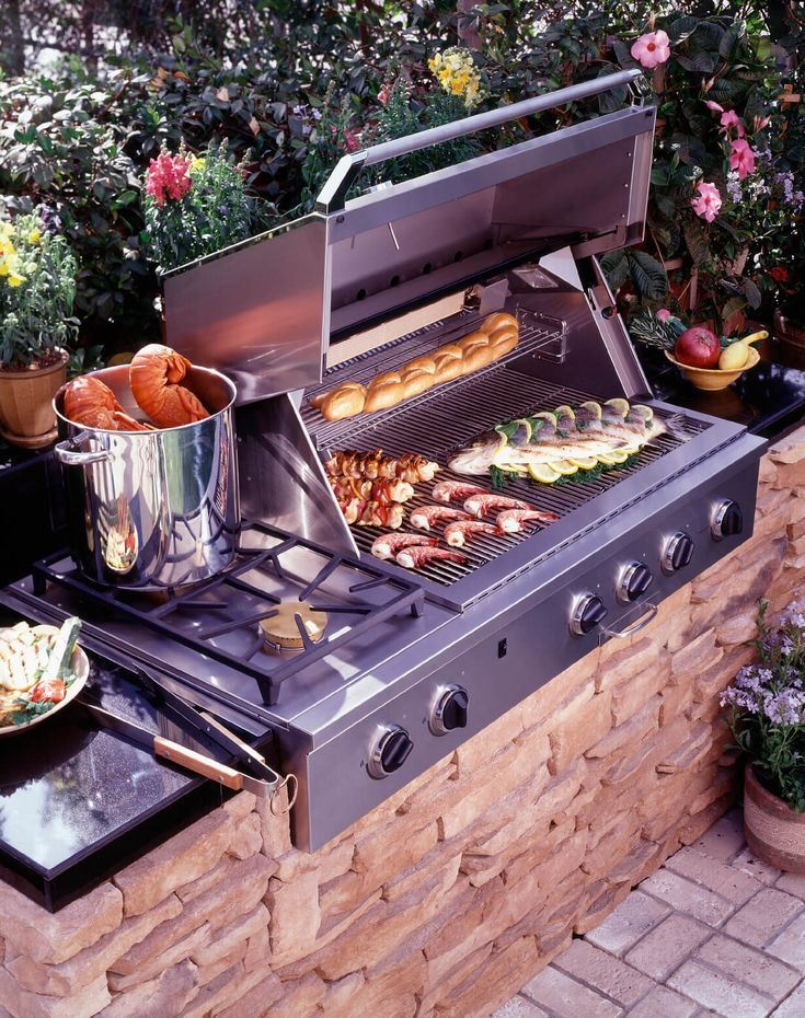 This Outdoor Kitchen In Miniature Centers On A Grill And Cooktop Built Into A St Outdoor Kuche Hinterhof Kuche Grillen Im Freien