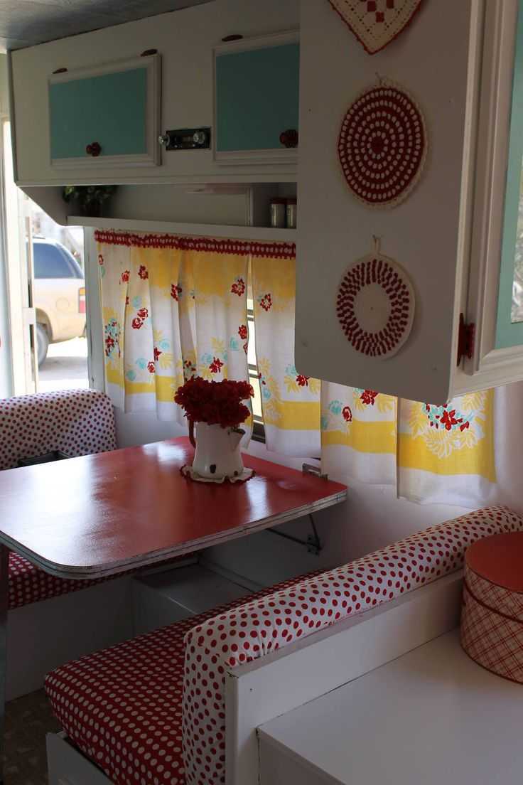 My 1984 camper redo. Vintage tablecloth made into curtains.