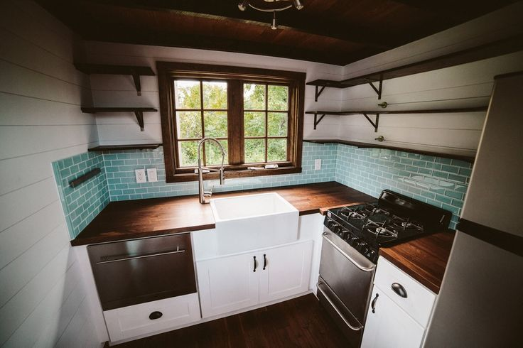 Love the tile and the sink in The Mayflower: a stunning, luxury tiny home, designed and built by Wind River Tiny Homes.