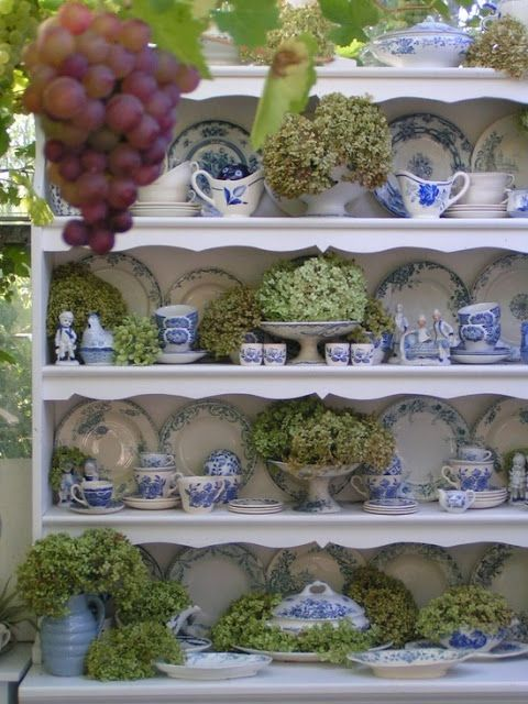blue and white dishes with green hydrangeas for the