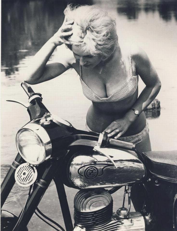 Historic Photo time! Blonde bikini clad lady admires a late '50s Jawa CZ motorcycle (built in Prague, Czechoslovakia). [ more histori...