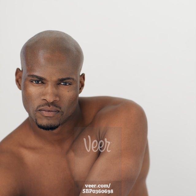 Young model with bald head and beard, portrait Stock Photo - Veer.com