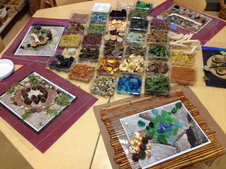 Different place mats, natural pictures, and loose parts. Have not thought about using photos with the loose parts.