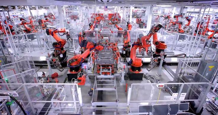 Tesla motors factory assembly line with robots Tesla