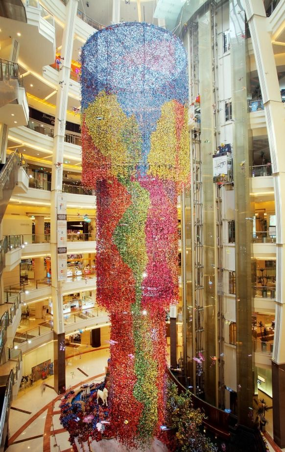 This is AMAZING!!  The whole thing is made out of butterflies!  Not to mention its 7-8 stories tall. (Preston Bailey Butterfly Installation Atrium Pacific Place Jakarta)