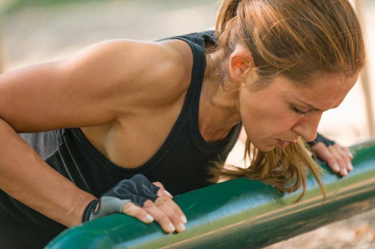 Female doing push ups outdoors