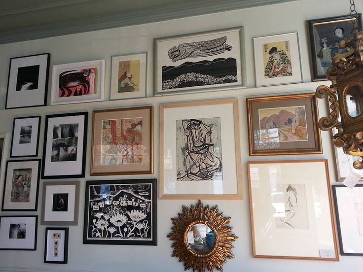 Salon Wall with various New Zealand Artists and Japanese woodblock prints.