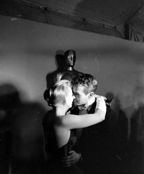 Paul Newman, with wife Joanne Woodward at the Academy Awards, 1958