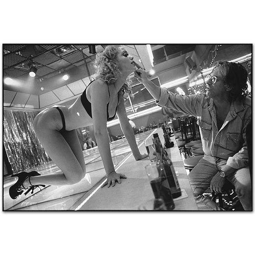mary ellen mark: elizabeth berkley with paul verhoeven adjusting make up, showgirls