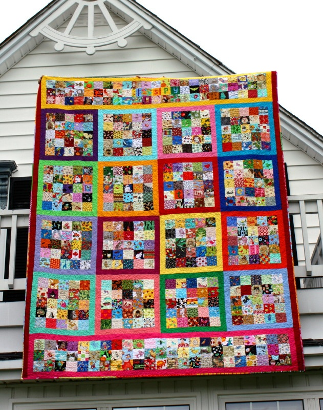 A giant I Spy quilt with over 500 unique fabrics! Frames around various sections--such a good idea.