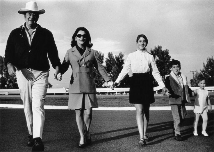John Wayne and his wife Pilar Pallete Wayne and their children daughter Marisa, son Ethan and daughter Aissa by Tom Allmon