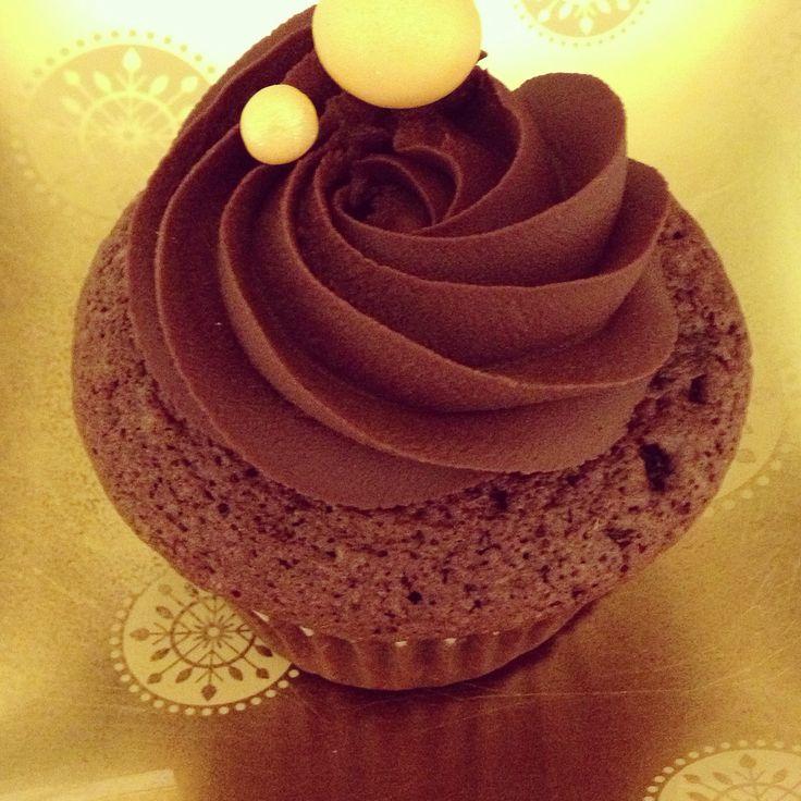 Dark choc mud cupcake with dark choc ganache and gold fondant pearls