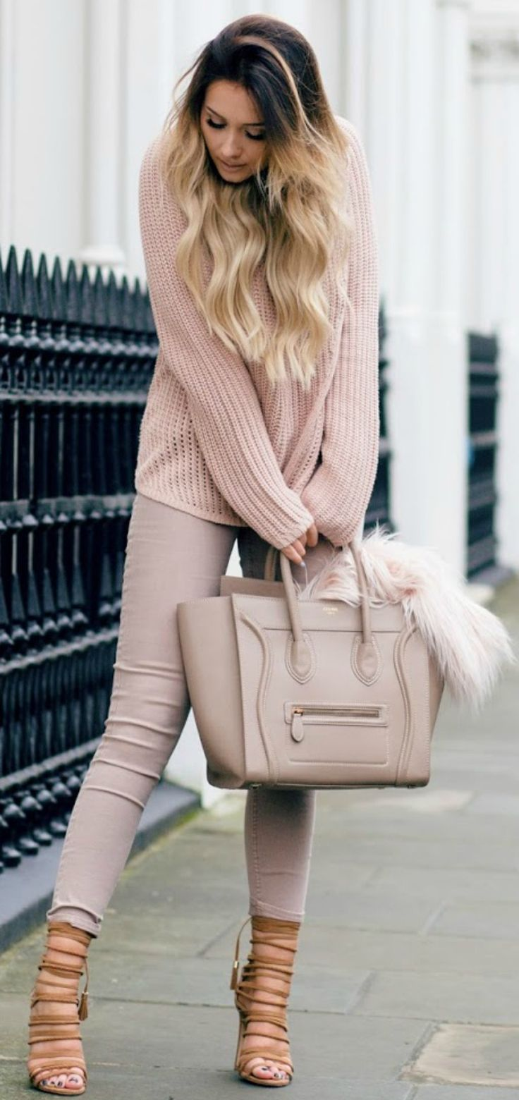 Sarah Ashcroft is absolutely working the nude trend in this pale pink matching sweater and jeans combination. Don't ever be afraid to be bold in a block coloured outfit like this one! Jumper/Jeans: H&M, Heels: River Island, Bag: Celine, Fluffy Coat (in bag): Missguided.