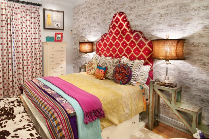 headboard upholstered with unusual shapes, pattern which is ideally resonates with a pattern on the curtains.