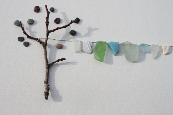 More pebble art by Sharon Nowlan...this would be a neat way to organize mismatched socks in a laundry room. Much better than my method, ie pile socks on top if dryer!