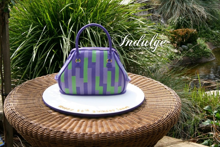 This amazing striped handbag is actually a cake! Made by Indulge Designer Cakes in Warragul, VIC (www.indulgedesignercakes.com.au) - isn't it fabulous!