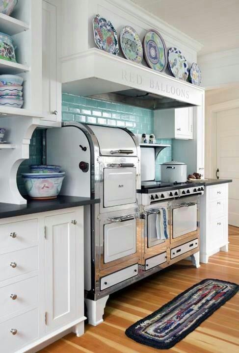 vintage stove with new hood and tile backsplash