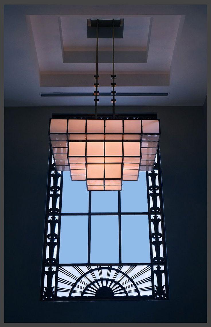 Art Deco chandelier against Art Deco window design