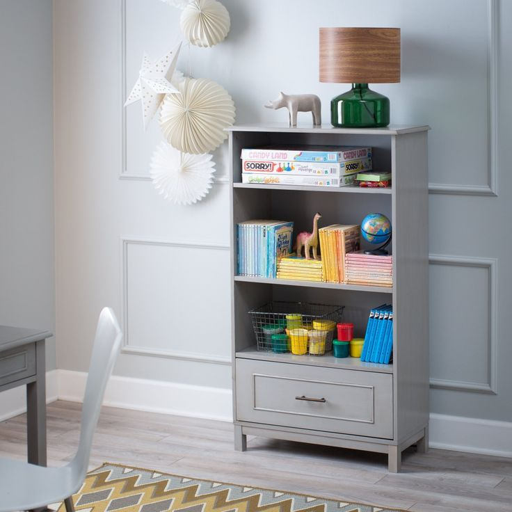 Stash, store, and stylize with the Classic Playtime Bennington Bookcase - Weathered Gray.
