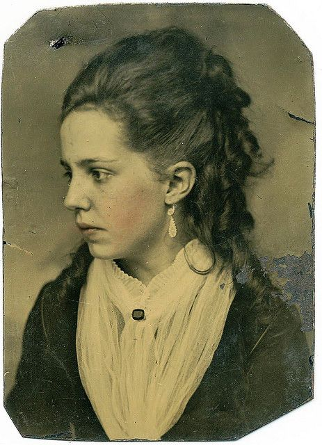 { a lovely image of a young lady with cheeks and lips tinted}