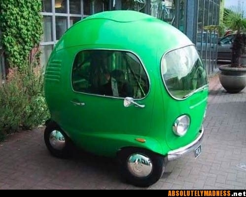 Tiny Green Car: was created in 2005 for a Birds Eye Peas TV commercial by Asylum Models and Effects in the UK. It's chassis's from a go-cart, the headlights from a VW Beetle, the indicators are Lancia, the engine is Honda and the rest is custom made.