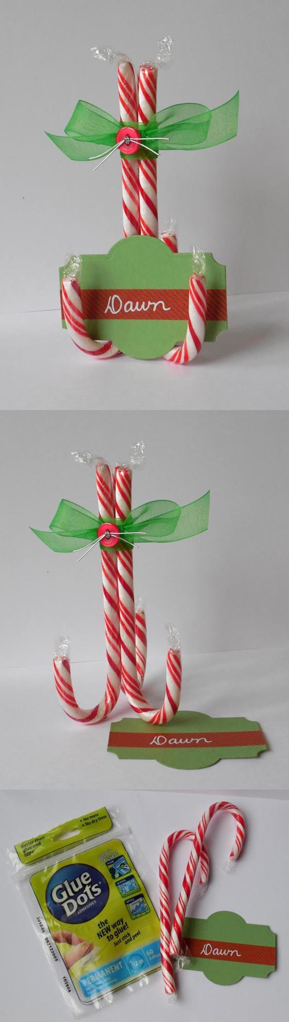 Candy canes + Ribbon + Permanent #GlueDots = Candy Cane Place Card holders! Add a sweet treat to your holiday table this year!