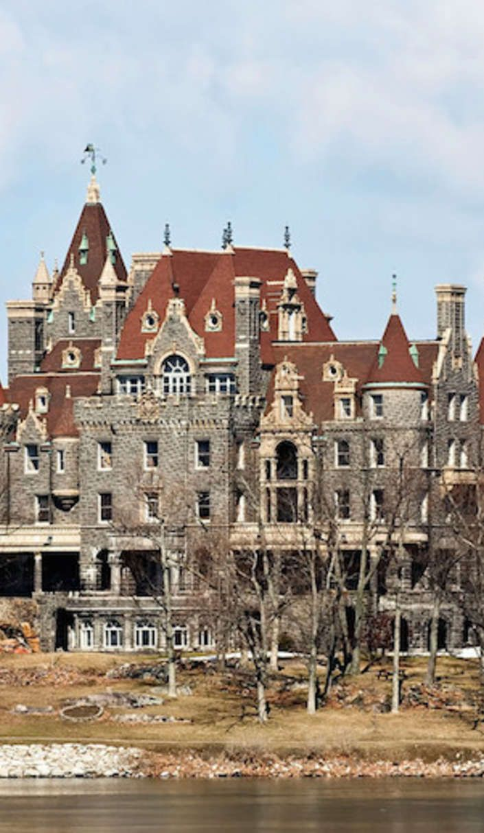 There's no doubt that Boldt Castle is one of the most gorgeous places in Alexandria Bay, New York, but the story behind this lovely and majestic building is a tragic tale of true love lost.