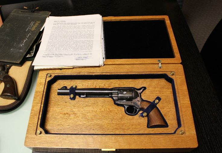 This undated photo provided by Olson Communications shows a Colt .45 revolver believed to have been carried by Wyatt Earp during the O.K. Corral. Sold for $225,000 this weekend 4/19/14