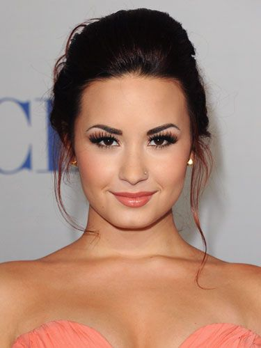 Demi Lovato coral lips, peachy cheeks and coordinating copper eyes.