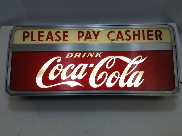 It's a lighted Coca-Cola counter top sign, manufactured by Price Brothers, Chicago, IL. It's in great and it works. I was trying to find out more information about this light, as to how old it might be?