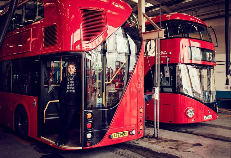 Thomas Heatherwick, in London, with two New Routemaster buses, which he designed. Photograph by Jason Bell.