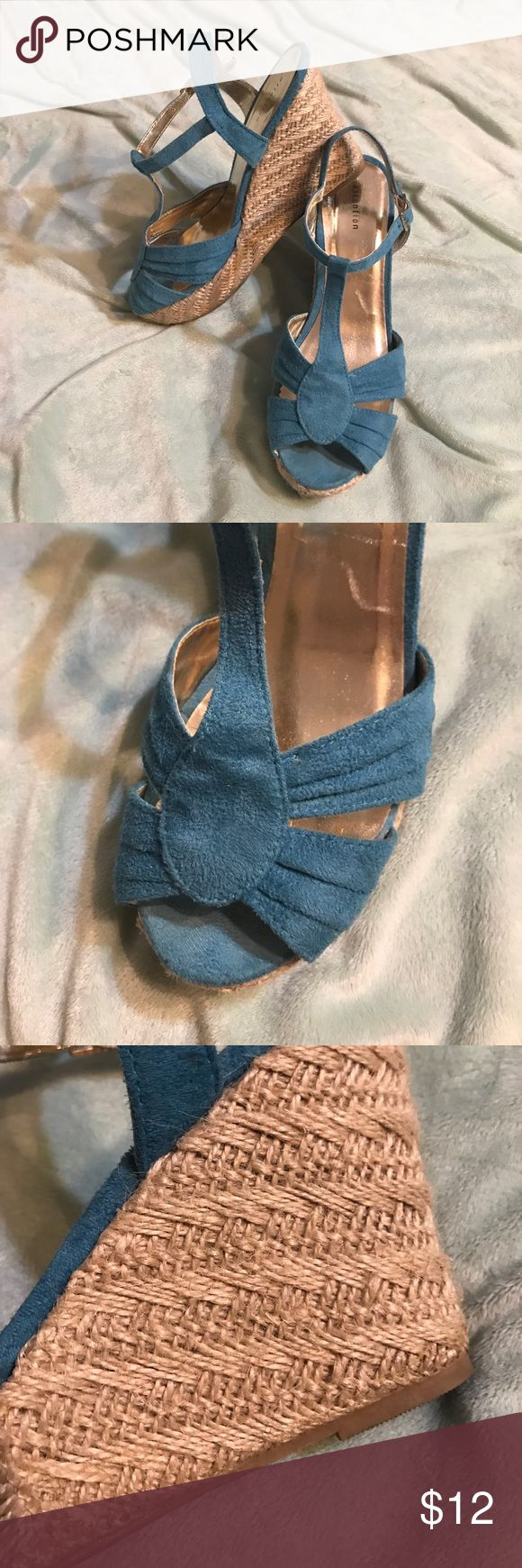 Turquoise wedge sandals. Size 8 So adorable. The woven wedge is so cute and turquoise is such a fun color. Size 8. Great condition Shoes Wedges