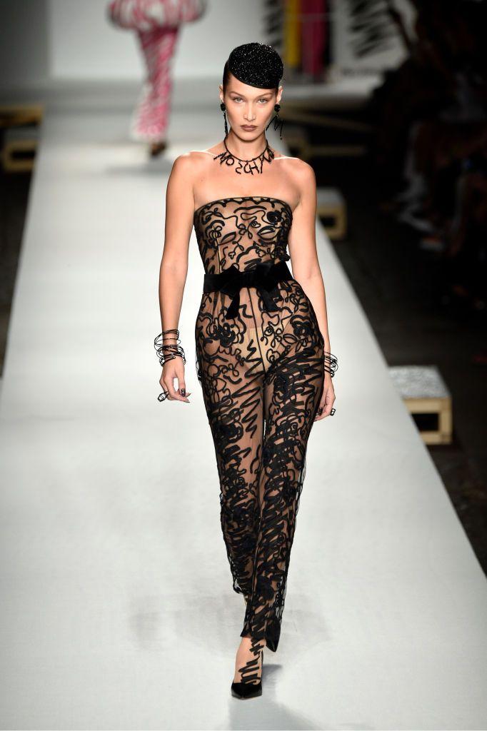 9eaa12955aa Bella Hadid walks the runway at the Moschino show during Milan...