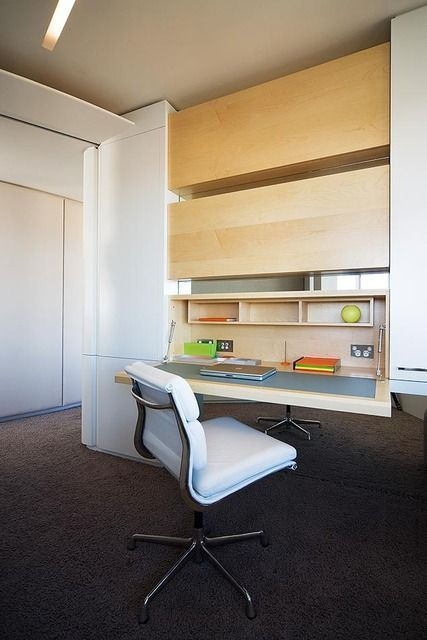Like the use of the whole wall to install desk, shelves and storage space: