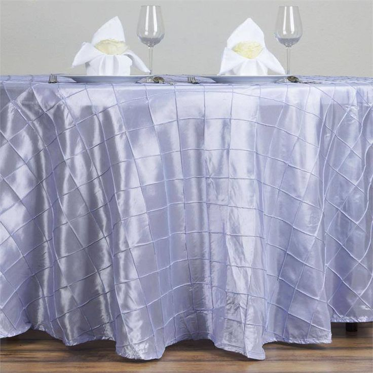 """Lavender Pintuck Tablecloths 120"""" Round - Pintuck is actually a fold of fabric that is stitched intricately to hold it in a place, very much like a pleat. These lovely pleats impart a decorative effect to the fabric by fashioning a visual line at a chosen point. They effortlessly bridge vintage and contemporary styles to create a majestic new classic look. If you do not want your celebration to blend in with other weddings, birthdays, and anniversaries, try our premium quality pintuck…"""