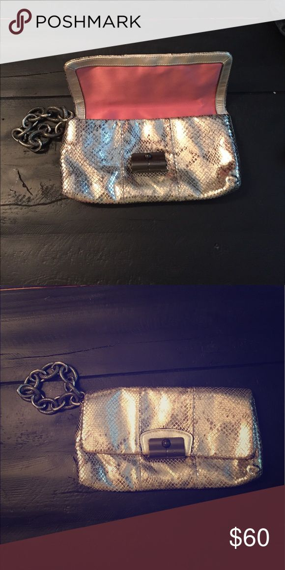 Designer coach metallic clutch with chain wristlet Gorgeous Coach gold and silver metallic clutch with oversized chain wristlet. Animal like skin pattern, two pockets inside. Condition is new. Coach Bags Clutches & Wristlets