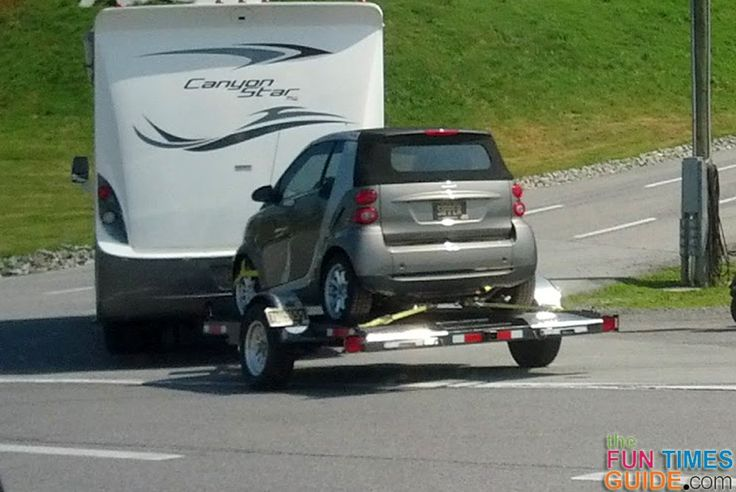 Using a flatbed trailer to tow a vehicle behind your motorhome. photo by Lynnette at TheFunTimesGuide.com