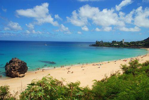 Sun bathe on The Kahanamoku Beach at Waikiki in Hawaii