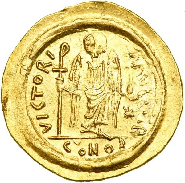 """Justinian I, 527-565. Gold Solidus (4.51 g) minted at Ravenna. AU Helmeted and cuirassed bust facing of Justinian I, holding globus cruciger and shield. Angel standing facing, holding long staff and globus cruciger; in lower right field, star. D.O. 333; S. 312. Rare. Light graffito """"K"""" in right obverse field. Spread fabric and a rounded border help identify this mint. Estimated Value $1,200 - 1,500. #Coins #Gold #Ancient #MADonC"""