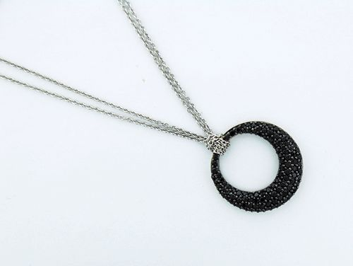 Sterling Silver Pendent with Black Cubic Zerconias, weigts 11 gram, with a sterling silver chain.