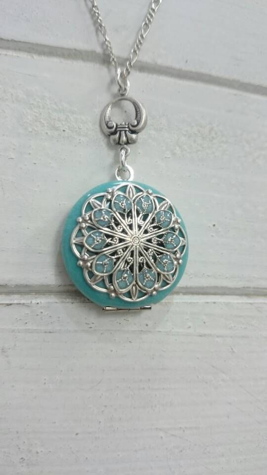 Check out this item in my Etsy shop https://www.etsy.com/listing/527699035/tiffany-teeny-tiny-vintage-style-locket